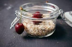 oatmeal and cherries in a jar