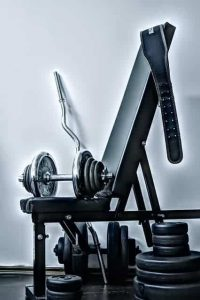 bench, dumbbells and weights