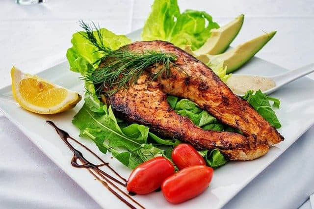 roasted salmon and vegetables on a plate