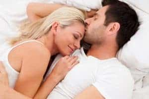 a woman cuddled up to a man