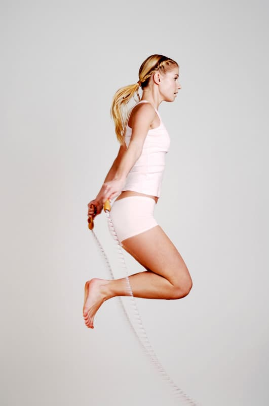 woman jumps on a skipping rope