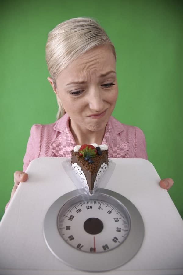 a woman holds the scales in her hands