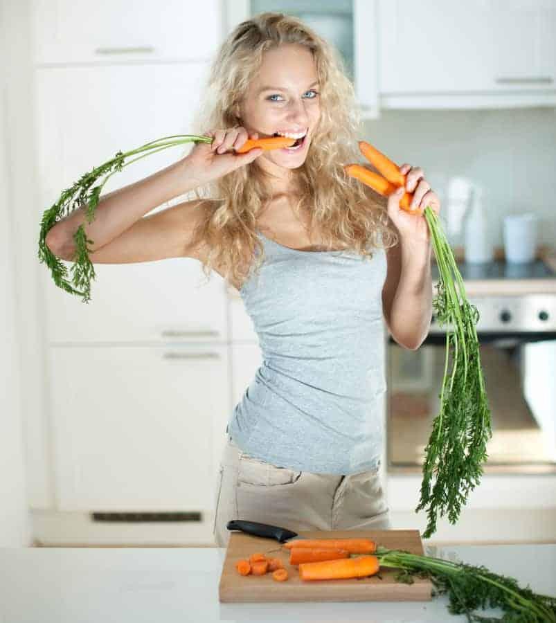 women eat carrots