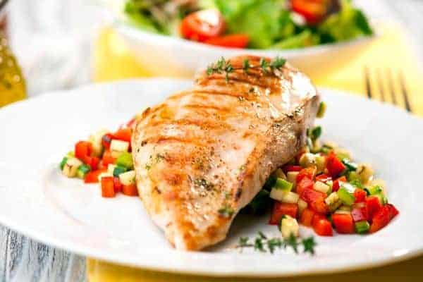 grilled fish with vegetables on a plate
