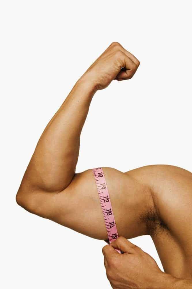 a man measures his biceps