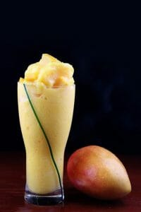 Cocktail with mango and mango fruit