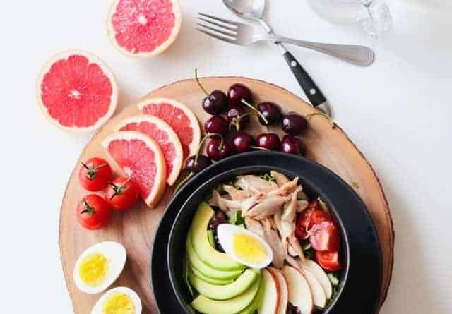 Vegetable salad with fish and eggs and fruit