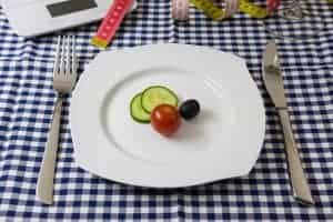 Cucumber, tomato and olive slices on a plate