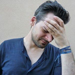 A man has a headache