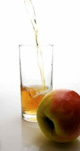 Apple and apple cider vinegar in a glass