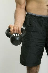 a man exercises with dumbbells
