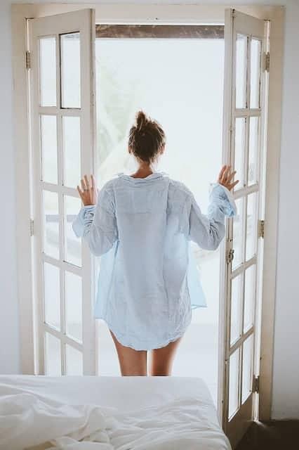 woman standing by the open door