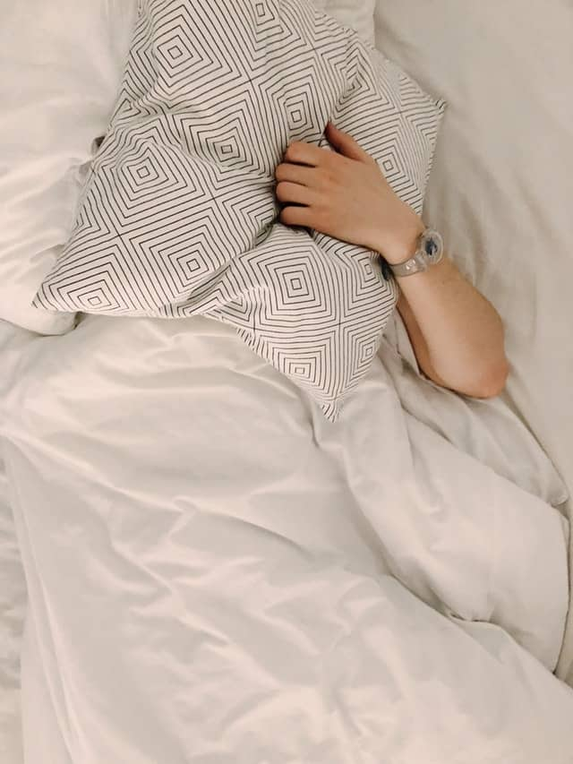 man covered with a pillow