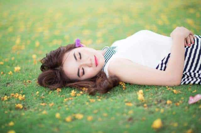 woman sleeping on the grass