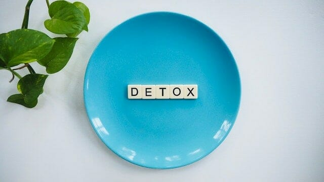 """The word """"detox"""" placed on a plate"""