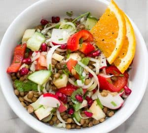 Fruit and vegetable salad with orange pieces