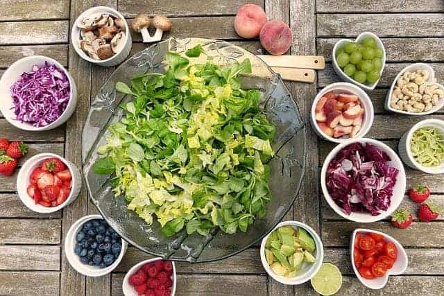 Vegetable salad and fruit in bowls