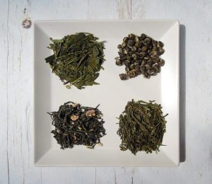 Four varieties of green tea on a plate