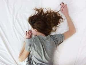 woman sleeps on a bed