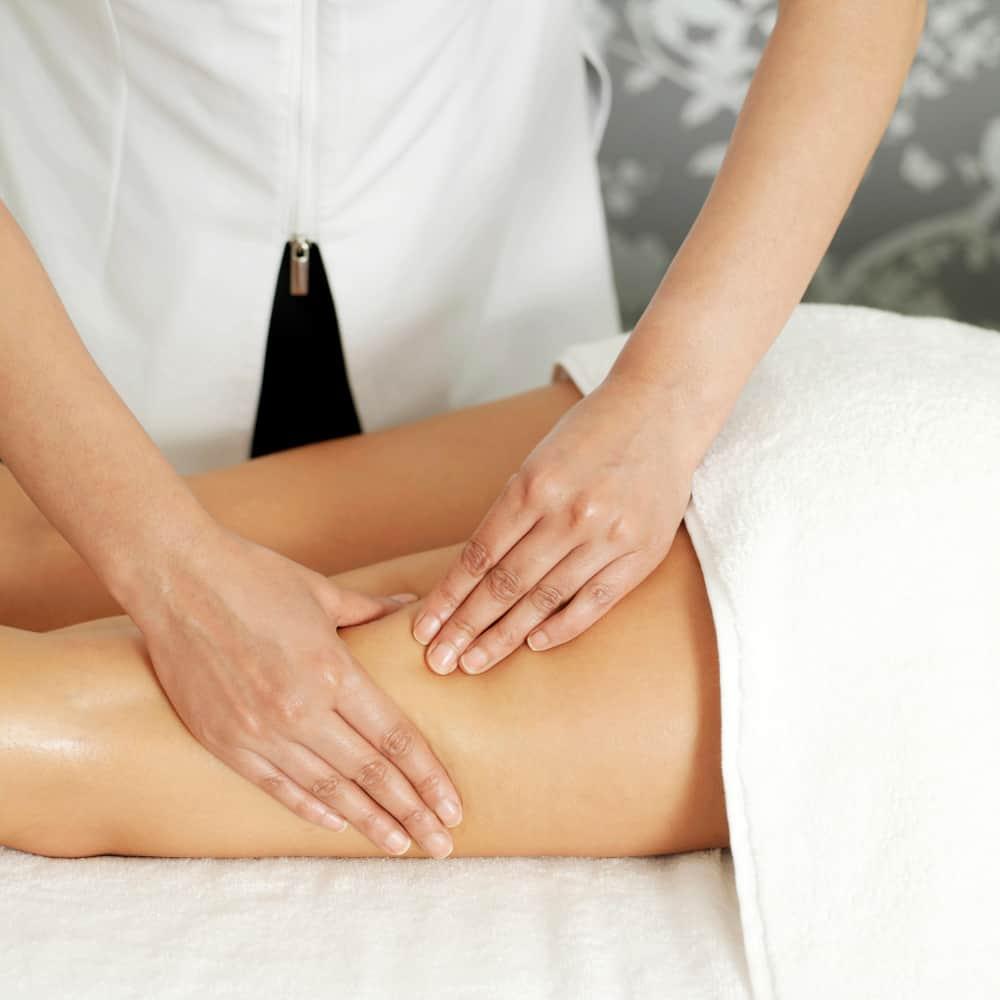 woman does a leg massage