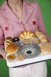 woman carries biscuits on the scale