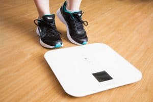 woman stepping on the scale