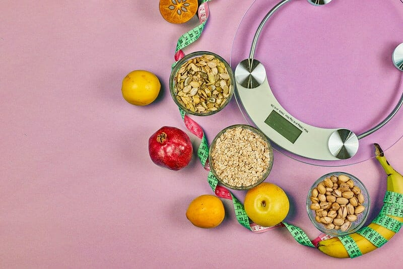 Kitchen scale and healthy diet food (grains, fruits)