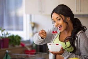 woman eats fruit