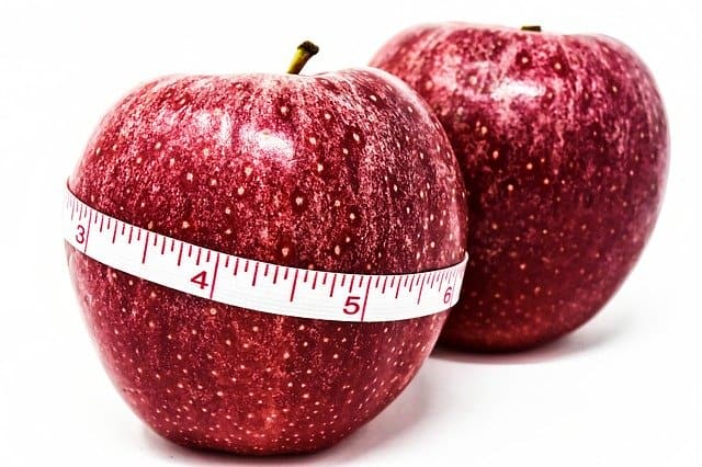 An apple tied with a centimeter, weight control