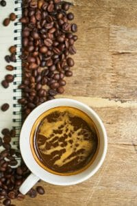 Coffee beans and coffee in a cup
