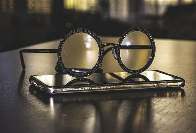 Glasses lying on the smartphone