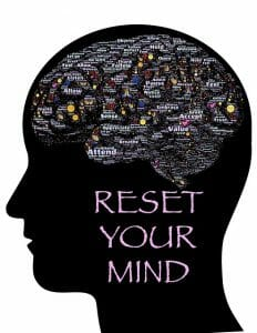 Illustration showing the head, the outline of the brain and the inscription: reset your mind