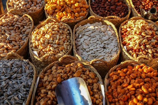 baskets with different kinds of grains and nuts