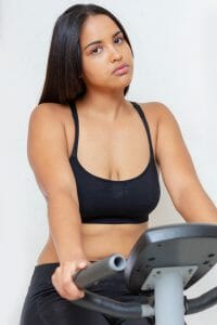 woman exercises on an exercise bike