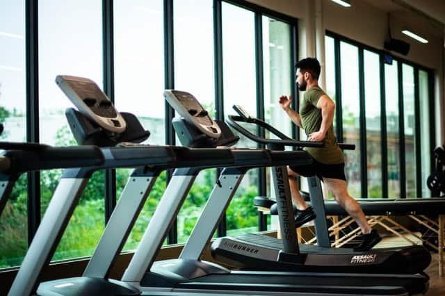 man runs on a treadmill