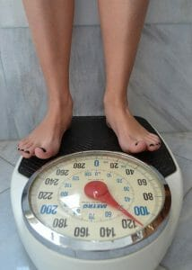 person standing on the scale