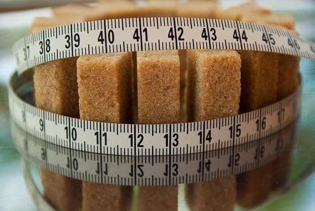 sugar cubes tied with a measuring cup