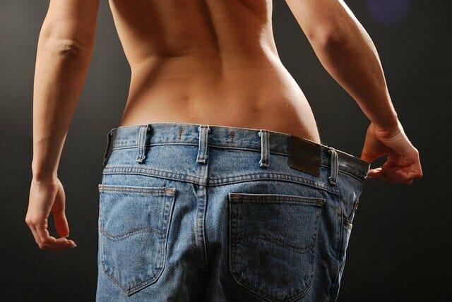 slim woman in too big pants