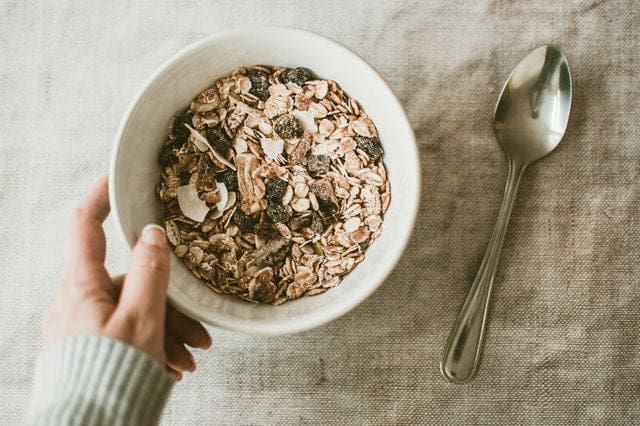 Oatmeal and dried fruit in a salad bowl